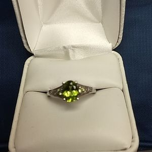 Oval peridot with small peridot accent stones